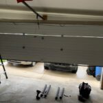 inside angle of a broken garage door open and crooked