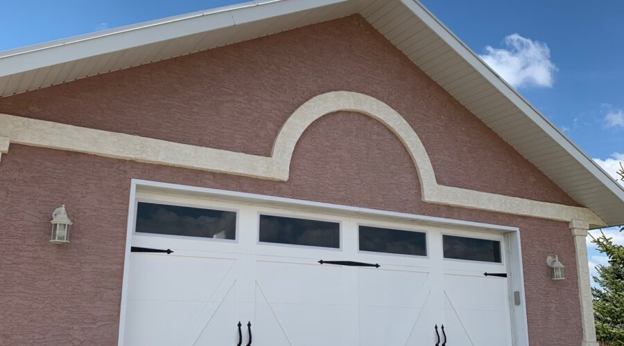 New barn style garage door after installation and paint and handles